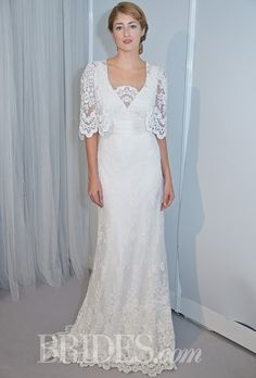 Brides.com: Our Favorite Lace Wedding Dresses from the Bridal Runways. Style 1910.2, scalloped lace over slipper satin sheath wedding dress with an illusion v-neckline, shown with lace three-quarter sleeve cape, Charlie Brear  See more sheath wedding dresses.