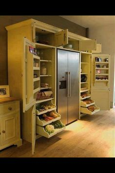 """Original caption: """"Neptune Grand Larder Unit: An elegant solution for all types of kitchen storage."""" Yeah, right, your kitchen would have have one long empty wall on it. Still like the idea. Maybe in the remodel. Kitchen Pantry, New Kitchen, Kitchen Storage, Kitchen Decor, Kitchen Cabinets, Kitchen Ideas, Pantry Storage, Pantry Ideas, Food Storage"""