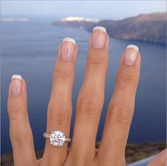This giant sparkly diamond solitaire engagement ring is the thing that dreams are made of!