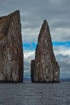 Kicker Rock - San Cristobal, Galapagos - Snorkelers and divers will find sea turtles swimming around the base of these rock formations off the coast of San Cristobal...and hammerhead sharks circling farther below!  #travel #galapagos #islands #equador #southamerica
