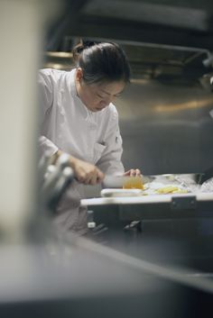 Asian female chef working in kitchen by Gable Denims on 500px