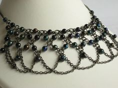 A beautiful beaded boho style bib necklace featuring an oxidized look chain and black aurora borealis beads. Make a statement with this fabulous choker length necklace. Add a splash of boho style to your wardrobe with this beautiful necklace. The ...