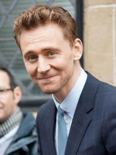 How adorable ..... With his smile the world seems to be a better place # Tom Hiddleston😍😍😍😍😍😍