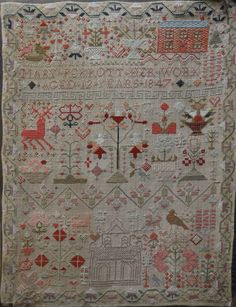 A Victorian child's coloured wool pictorial sampler with place of worship, domestic animals and f
