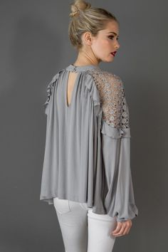 In a flowy silhouette, this lace shoulder blouse features sheer crochet detailing on the shoulders. Button closures at the front neck. Stylish Tops, Stylish Dresses, Casual Dresses, Dress Shirts For Women, Blouses For Women, Kimono Fashion, Fashion Dresses, Classy Gowns, Sleeves Designs For Dresses