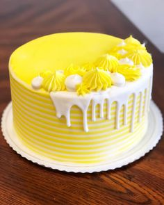 Fun sunny drip cake to brighten your day! This yellow and white striped cake with perfect drip and dollops just puts a smile on our face! Lemon Birthday Cakes, Yellow Birthday Cakes, Yellow Cakes, Elegant Birthday Cakes, Birthday Cake Decorating, Cake Decorating Tips, Cupcakes, Cupcake Cakes, Striped Cake