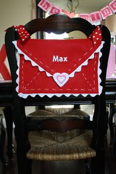 Adorable Handmade Valentine's Day Envelope Chair Backer!  A cute decoration that can be a tradition for the family to take turns writing sweet notes leading up to Valentine's Day!