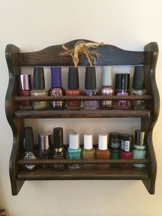 Upcycled spice rack that I refinished and turned into a nail polish rack for my daughter. Added a little embellishment at the top for decoration! Nail polish organization!