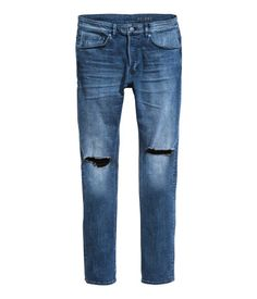 Dark denim blue. 5-pocket low-rise jeans in washed stretch denim with hard-worn details, a button fly and skinny legs.