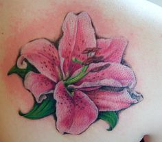 What does lily tattoo mean? We have lily tattoo ideas, designs, symbolism and we explain the meaning behind the tattoo. Cap Sleeve Tattoos, Up Tattoos, Great Tattoos, Hand Tattoos, Girl Tattoos, Floral Tattoos, Tatoos, Lily Tattoo Meaning, Tattoos With Meaning