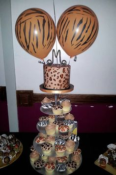 Animal printed birthday cake and cupcakes