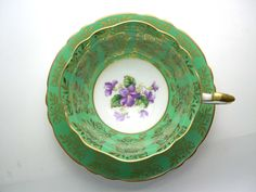 Vintage Paragon Tea cup And Saucer, Green and gold tea cup and Saucer, Tea cup with violets. by AntiqueAndCrafts on Etsy