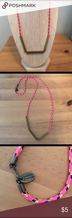 Maison Scotch Neon and Brass Necklace Maison Scotch Neon Pink & Yellow cord necklace with three sliding brass rectangle beads, lobster clasp & logo tag at clasp. Approx 29 inches. Worn once and in like new condition. Maison Scotch Jewelry Necklaces