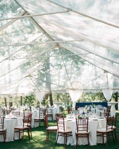 Skylight Tent | Martha Stewart Weddings - To avoid competing with the surrounding scenery, this couple chose a clear Briggs tent to cover their reception space. After sunset, the cover reflected the candlelight and bistro lighting, giving the space a warm glow.