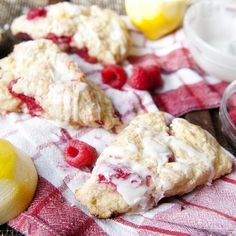 Scones that are soft on the inside, ever so crispy on the outside and loaded with fresh raspberries. Topped with a tart lemon glaze.