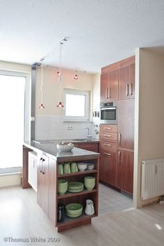 Making This Home: Simple Joys of a Small Kitchen - The Inspired Room  A wonderful article