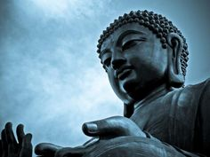 What Is Enlightenment in Buddhism: Close-up of giant Buddha in Ngong Ping village, Hong Kong.