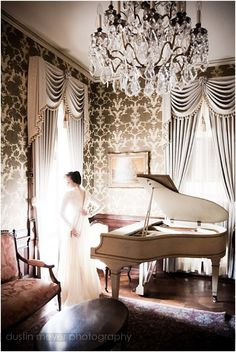 I like the concept but not the execution... I would have tried landscape, keeping the window light in play with the piano... getting the height of the beautiful room is nice, but its the bride I'd be more concerned about.  Still like the photo, but this is how I'd do it differently.