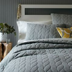 This looks like it could work with the duvet cover from RH.  and it is in stock, ready to ship.  Braided Quilt + Shams - Plaster