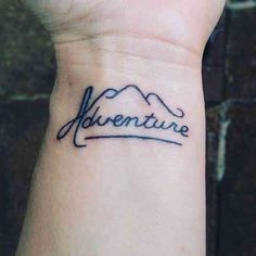 Mountain and adventure travel tattoo