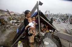 In Philippines, battered town stops waiting for help, gets busy rebuilding - Air crew onboard a U. Navy helicopter attached to the aircraft carrier USS George Washington carry out a search Friday north of typhoon-ravaged Tacloban, Philippines Islamic Relief, Hits Close To Home, Global Awareness, Tsunami, Destruction, Climate Change, Tent, World, People