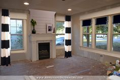 Treat windows flanking fireplace to coordinate with side windows rather than match.