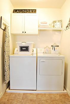 Laundry Room - hooks along the walls great idea for hang to dry items, and ironing board - do you have a full size ironing board? I have one of those small ones from Ikea that I use right on top of my dryer.