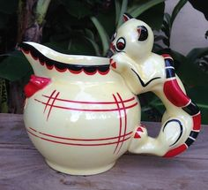 """CZECHOSLOVAKIAN POTTERY This is a crazy rare item. This jug combines the look of a Cat handled pitcher, a Cat and Mouse animal piece and a full sized DU Pitcher. This piece is nearly 8"""" x 10""""-"""