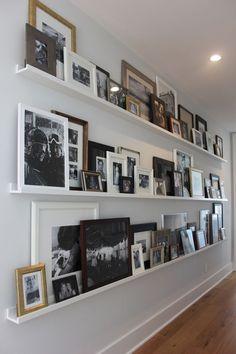 HGTV's Jasmine Roth Has An Awesome Alternative To The Basic Gallery Wall - 6743 Cadence Boulevard - HGTV& Jasmine Roth Has An Awesome Alternative To The Basic Gallery Wall – Gallery Shelves - Hallway Walls, Hallway Ideas, Wall Ideas, Hallway Shelving, Shelf Ideas, Upstairs Hallway, Long Wall Shelves, Shallow Shelves, Hallway Art