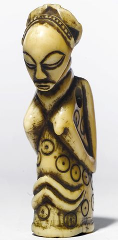 Africa | Amulet from the Luba people of DR Congo | Ivory; hippo canine tusk. Golden ivory patina with light brown residue | height 4 in. 10.2 cm | 55'000$ ~ sold (May '08)