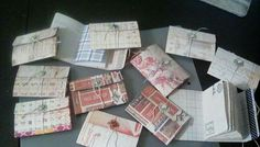 """Finally finished something new for me... 12 mini notebooks with brad and string closure and stapled in.. 10 sheets, 20 pages, 40 sides to write on. Measures 4  1/4"""" x 3"""" closed . Pages are either coffee dyed, graph, or colored pattern paper mixed up. Covers are Tim Holtz Correspondence paper."""