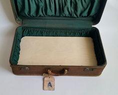 Hometalk :: Repurposed Vintage Suitcase to Storage Table