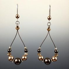 Swarovski crystals and Swarovski crystal pearls Hand formed Sterling silver earwires with rubber earring backers Beads are strung on a colored, stainless steel Pearl Jewelry, Wire Jewelry, Jewelry Crafts, Sterling Silver Jewelry, Beaded Jewelry, Handmade Jewelry, Jewelry Rings, Geek Jewelry, Gothic Jewelry