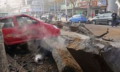 Rubble of a damaged road after an explosion at a Sinopec Corp oil pipeline in Huangdao, Qingdao