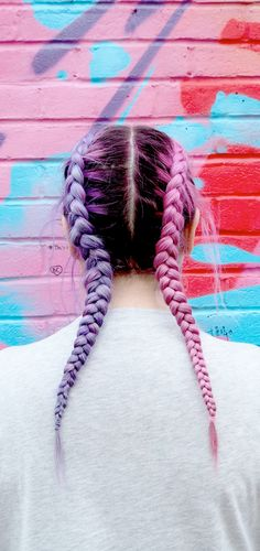 Here is @iamlazykat with her awesome two tone hair plaits! pink and purple hair is the best kind of hair! plaits add extra cool points! I love coloured hair with super dark roots. such a good look and I love the street art too! photo taken in shoreditch, east london. Don't you just love rainbow coloured hair? Wear with a patched denim jacket, unicorn tee shirt and mermaid tattoos! Check out her blog http://www.lazykat.fr