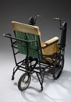 Most manual wheelchairs are powered by the user turning the wheels directly. This chair, by contrast, is driven via chains by two hand cranks either side of the user. The chair has three main wheels. With a supportive wheel at the rear, flanked by two small stabilising castors for balance when turning, the chair let the user drive without bending to turn the wheels. The mechanism allegedly needed less effort to turn the wheels. It was made by British company Richards. 1910-1920