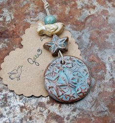 Blue ceramic starry sky disk pendant and bird bead set… Gaea Ceramic Bead and Art Studio Blog || Gaea.cc