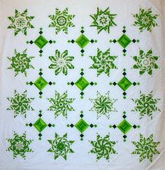 """Absolutely stunning """"Snug as Peas in a Pod"""" quilt top by Linda Rotz Miller. It's worth enlarging this pin! Made using the LeMoyne Star pattern and the stack and whack method. (One such helpful tutorial for that here: http://sisterofthedivide.blogspot.com/2012/07/tutorial-creating-stacked-lemoyne-star.html) Good close up of Linda's blocks here: https://www.flickr.com/photos/52794248@N06/16278887300/"""