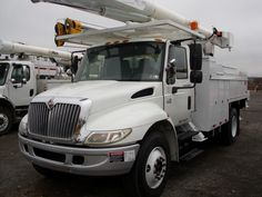 55' Working Height AM650 Altec on a 2004 International 4400 4x2.  This bucket truck is insulated with a 2000lb jib capacity material handler and a single man rotating bucket. There are 4 outriggers on this truck and it comes equipped with a hydraulic hose reel.SR# 3759  http://www.sunriseequipment.com/55-altec-am650-on-a-2004-international-4400-4x2