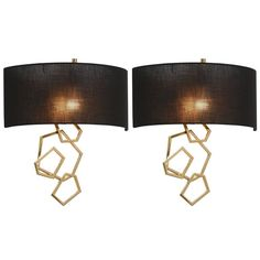 Pair of European Modern Gold, Brass and Black Shade Wall Sconces | From a unique collection of antique and modern wall lights and sconces at https://www.1stdibs.com/furniture/lighting/sconces-wall-lights/