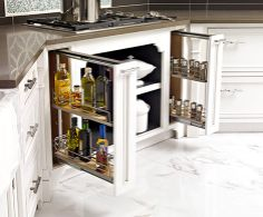Plain & Fancy   Plain & Fancy Fine Cabinetry maximizes space with dual pull-out pantries flanking the stove for storing bottles of seasonings and oils