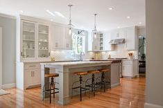 Tvílitt? Kitchen of the Week: Warm and Industrial in New Hampshire..Generous helpings of wood keep white subway tile and cabinets from feeling cold in a kitchen redesigned long-distance