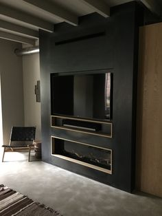 Bespoke M design gas fireplace with blue steel panels, samsung smart tv with sonos play bar