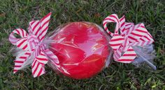 Outdoor Christmas candy. Roll a ball in cellophane wrap, tie with ribbon.