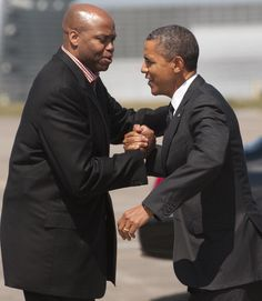 President Barack Obama greets Craig Robinson, brother of First Lady Michelle Obama