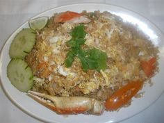 Crab Fried Rice :Fried rice with crab meat, imitation crab, egg, onion, tomatoes, peas, and carrots. #egg #vegetables #Awesome Thai #Food forked.com