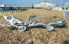 Ptolemy Elrington is 43-year-old artist from United Kingdom who use old hubcaps to make dogs, fishes, birds, dragon and other sculptures with knife and hacksaw.beach-steel-sculpture