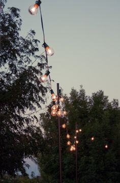 Excellent tutorial on establishing poles around your patio/deck to attach your cafe lights to if needed~ AND.... They now have these with the vintage bulbs at Home Depot for $20!!