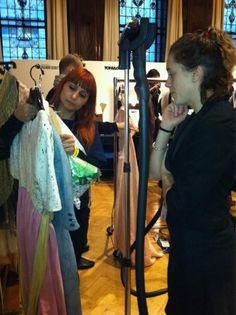 Here is #styliststuff briefing a dresser backstage at #Prophetik #LFW #HarrodsLive