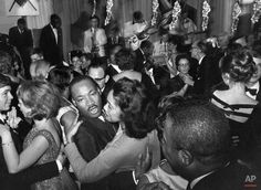 In this Dec. 13, 1964, file photo, Dr. Martin Luther King, Jr., and his wife Coretta Scott King, dance at the Malmen Hotel in Stockholm, Sweden where he was a guest of honor on the one year anniversary festivals for the Republic of Kenya. Three days earlier, Dr. King received the Nobel Peace Prize. (AP Photo/Reportagebild, File)